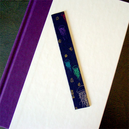 Jellyfish Bookmark 2, with book, by Amy Crook
