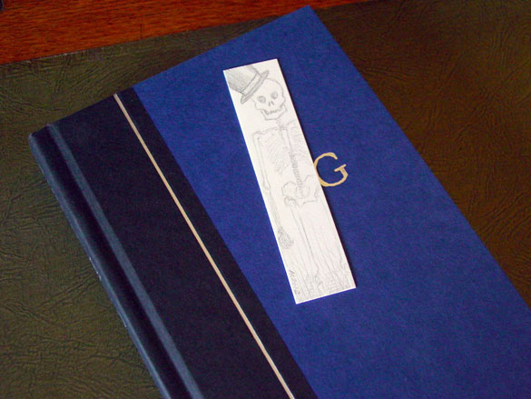 Skeleton Bookmark, with book, by Amy Crook