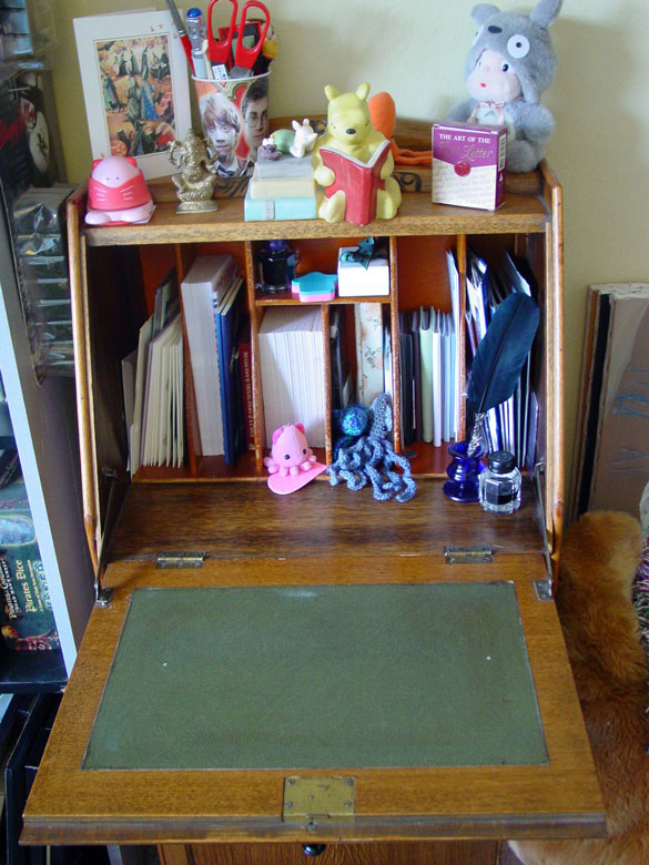 the inside of my writing desk, including a lot of adorable photography props