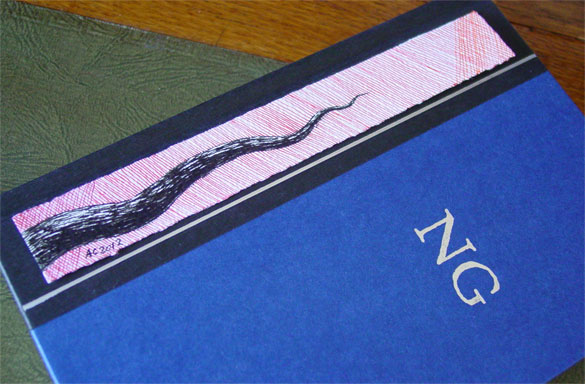 Tentacle Bookmark 1, with book, by Amy Crook