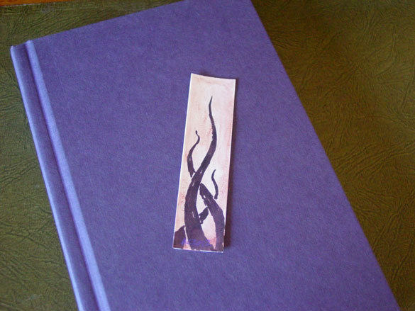Tentacle Bookmark 4, with book, by Amy Crook