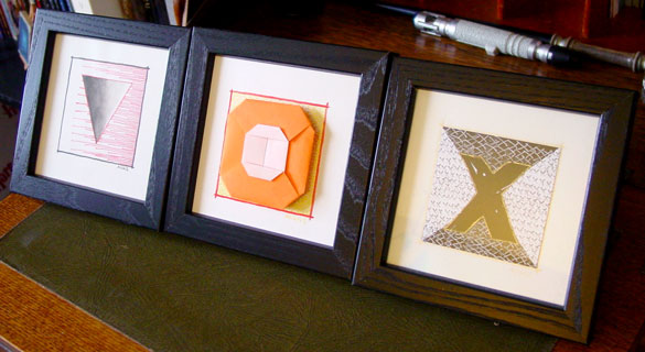 V, O and X, framed art by Amy Crook