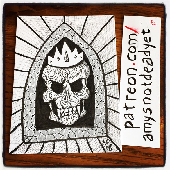 pen and ink art of a fanged skull in a crown resting in an arched niche