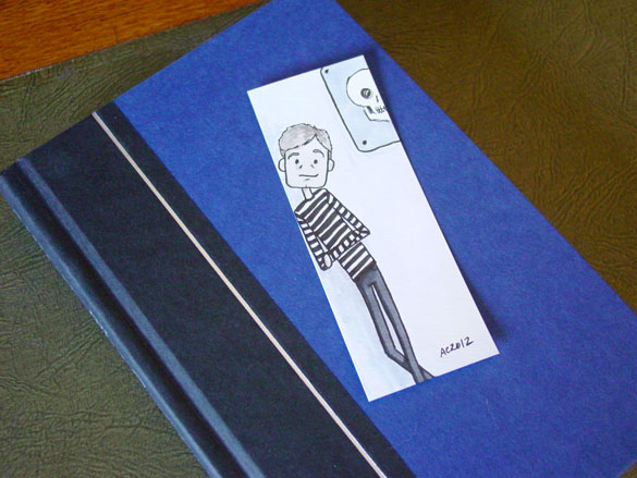 John Watson Bookmark 1, with book, by Amy Crook