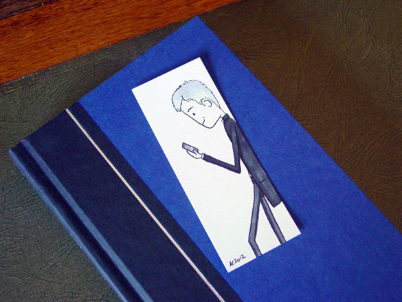 Lestrade Bookmark 1, with book, by Amy Crook