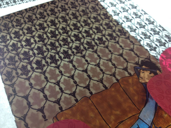 Sherlock on the light table getting wallpapered