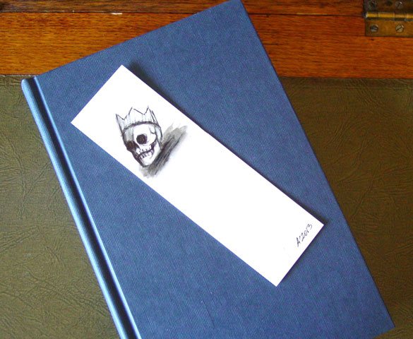 Skull Bookmark 3, with book, by Amy Crook